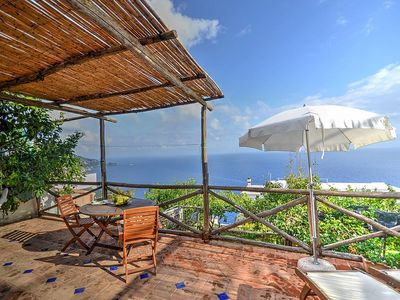 Photo for Casa Chicca: A graceful cottage built on the sloping cliff in front of the sea, with Free WI-FI.