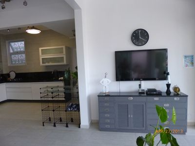 47' TV that can be viewed from large patio, living area and dining area.