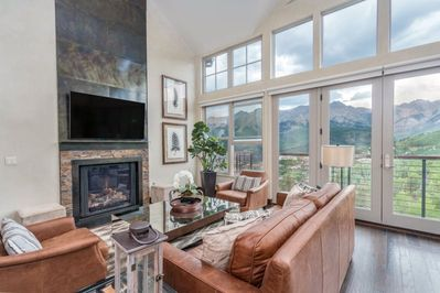 Sleek and sophisticated living area with a gas fireplace to enjoy