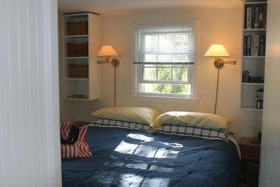 King size bed, large armoire, a closet and shelves for all your summer readi