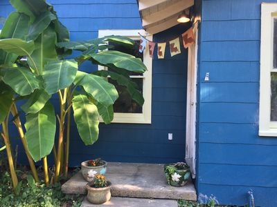 Front stoop with Louisiana prayer flags