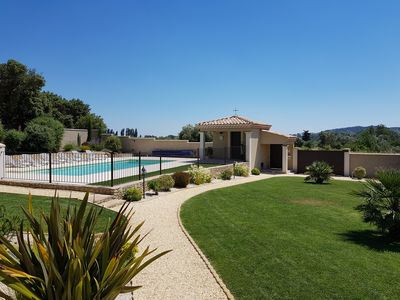 Photo for Charm and prestige: new cottage, quiet, air-conditioned, swimming pool near Pont du Gard, Uzès