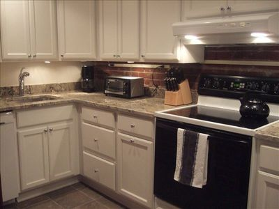 Full-size kitchen with granite countertops