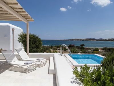 Photo for PAROS SANTA MARIA BEACH VILLA AMINA 3 BEDROOMS. PERFECTLY NESTED IN SANTA MARIA COASTLINE FRONT