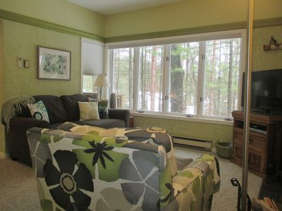 Photo for Chic condo tucked in the wooded dunes of Lake MI