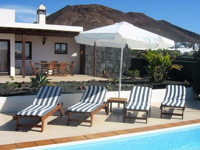 Photo for 300m to beach, heated pool, luxury 2 bedroom bungalow