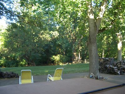 The backyard, the view from behind the hot tub on the patio