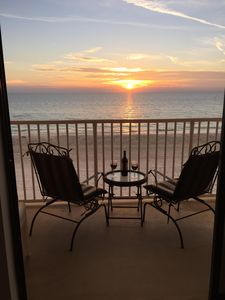 Enjoy a glass of wine while watching the sunset from the balcony.