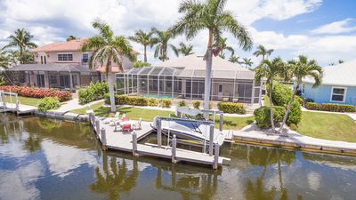 Photo for Spacious 4BR on Canal - Screened Deck w/ Heated Pool & Private Dock
