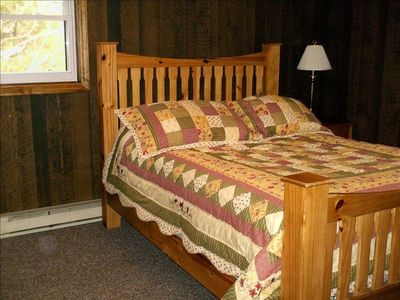 Queen bed in one of the upstairs bedrooms