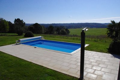 South facing heated swimming pool