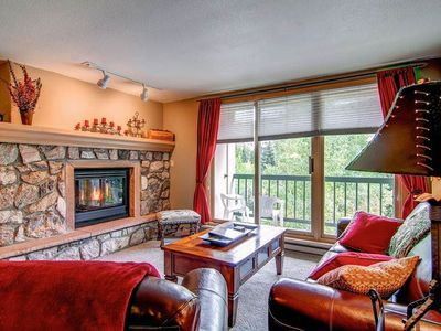 Photo for Ski in and out of this mountain view condo with shared pool and hot tub