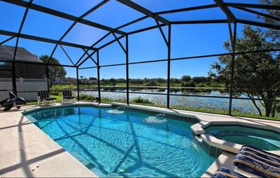 Photo for Two Master Suites with direct access to Pool!    NO rear neighbors   Minutes to Disney