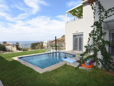 Photo for This modern holiday home with pool Thios distinguished by its striking design, its spacious rooms and selected wisely means. It can get space up to 7 people. On foot you can reach the center of the village Panormo in the north of Crete, where several shops and sandy beaches are.