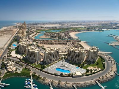 Photo for Al Hamra Marina apartment with stunning views near beach, golfclub and hotels.
