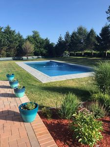 Photo for Sunny Breezy  Beach House With Huge Pool Overlooking  Fields