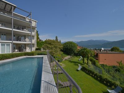 Photo for The View - Sky: design apartment with terrace, lake view and pool