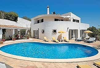 View of villa and pool with bbq area on the left