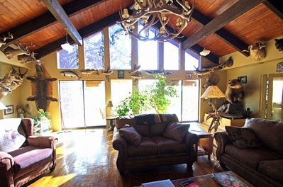Great room sitting area looking out onto the deck overlooking the canyon