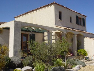 Photo for Between sea and scrubland, villa with garden and swimming pool