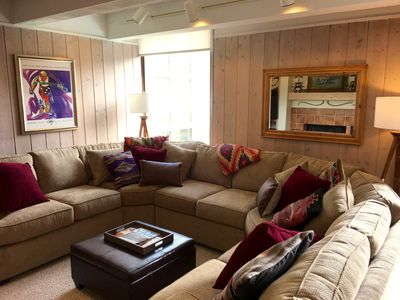 Family Room includes a custom, wrap-around couch to fit the entire family.