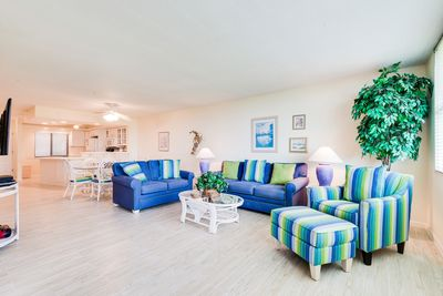"""Living room w/ sleeper sofa with extra thick 8"""" mattress"""