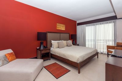 Master suite with king bed and TV