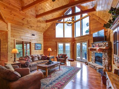 Photo for Dog-friendly luxury cabin with hot tub, game room, & wrap-around deck!