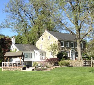 Stunning 3500 stone home on immaculate 50 acre horse farm.