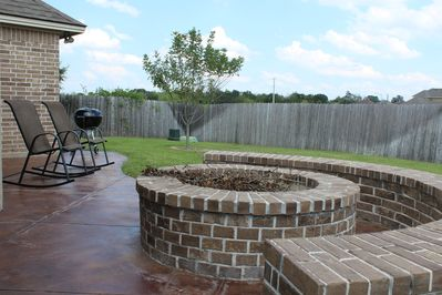 Great grilling patio w fire pit and plenty of space in backyard.