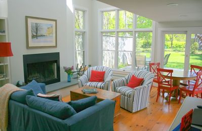 Family room from kitchen, deck and large yard beyond