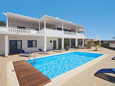 Photo for Modern villa w/ views of the harbour, heated pool and free Wi-Fi