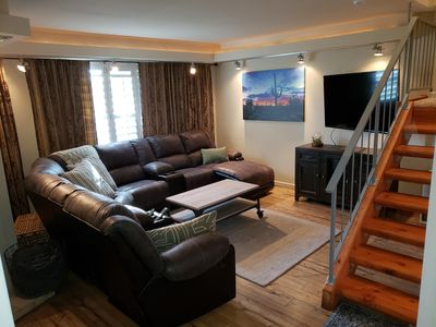 A view of our Family room.  Large smart  TV flatscreen.  Comfortable seating.