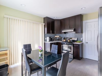 Photo for LUXE New York w/deck! 4BR/2BA 1 block from train!