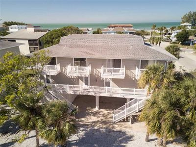 Photo for Immaculately Furnished 2BD/2BA, Steps from the Gulf w/ Heated Pool and Laundry