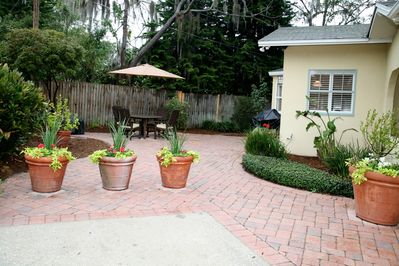 Brick paver patio with covered dining area, gas grill, and fire pit!