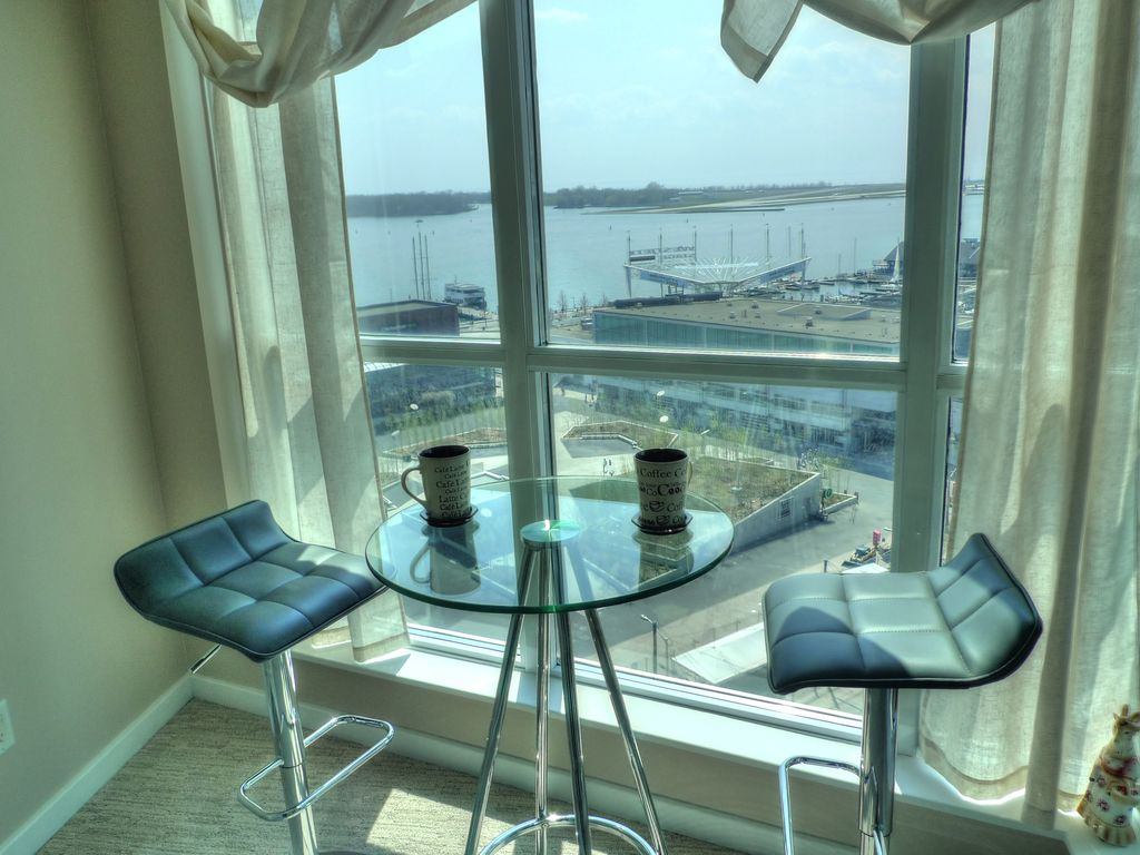Central Waterfront Apartment Rental Sun Room With Ustructed View