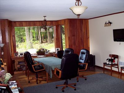 Hardwood floors and cherry wood paneling throughout house