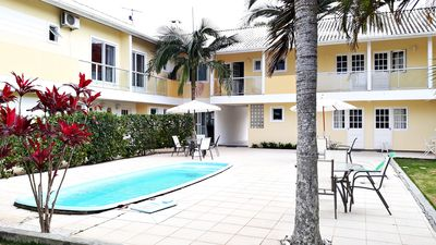 Photo for Residential with Kit, Apt and Duplex. Pool, games, barbecue! From 2 to 5 pax