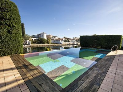 Photo for Lovely apartment for 12 people with private pool, WIFI, TV, pets allowed and parking