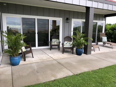 4 adjustable hotel style loungers and 4 Adirondack chairs.