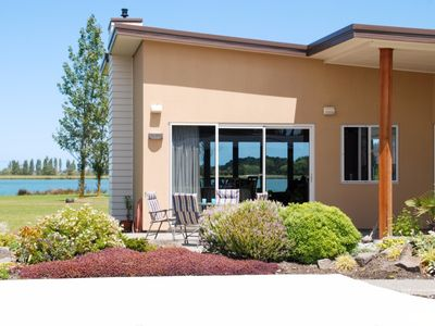 Photo for Warm and peaceful with unobstructed lake views.