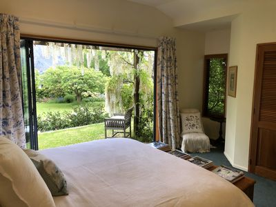 Master bedroom with garden, lake & mountain views