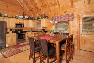 Fully equipped kitchen and dining area.  Seating for 8