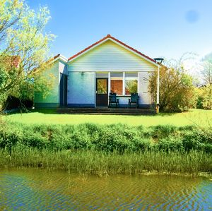 Photo for 4 pers. Waterfront Chalet close to the national park Lauwersmeer