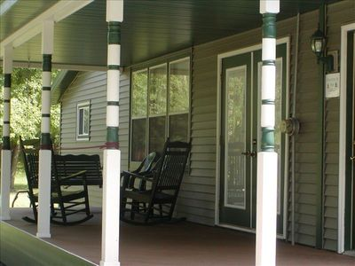 Relax on the Front Porch.  Enjoy the built in swing, the rocking chairs.
