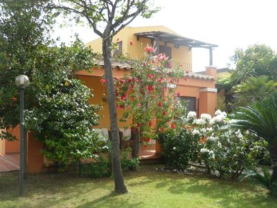 Photo for arbatax tortoli: elegant and prestigious villa with green lawn and flowers