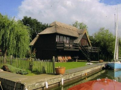 Photo for A Beautiful Traditional Thatched Boathouse With Accommodation For Up To 8