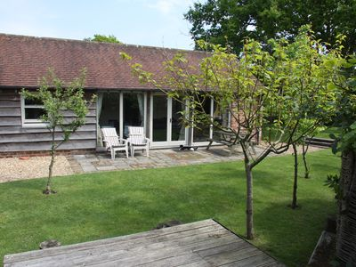 Photo for Charming Holiday Cottage With Large Sunny, Secure Patio And Garden