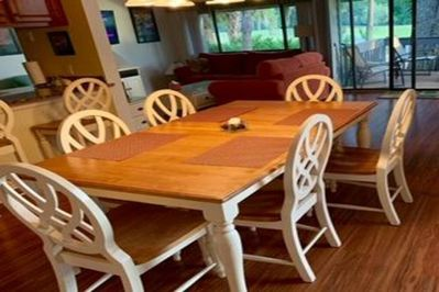 Dining table with 6 chairs and 2 bar stool chairs.